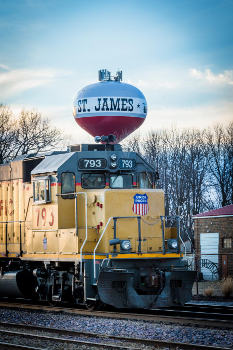 St. James water tower with train in front