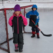 Two kids on ice rink