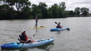 Image of people kayaking and paddle boarding on St. James Lake