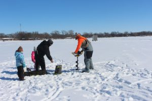picture of people on frozen lake ice fishing